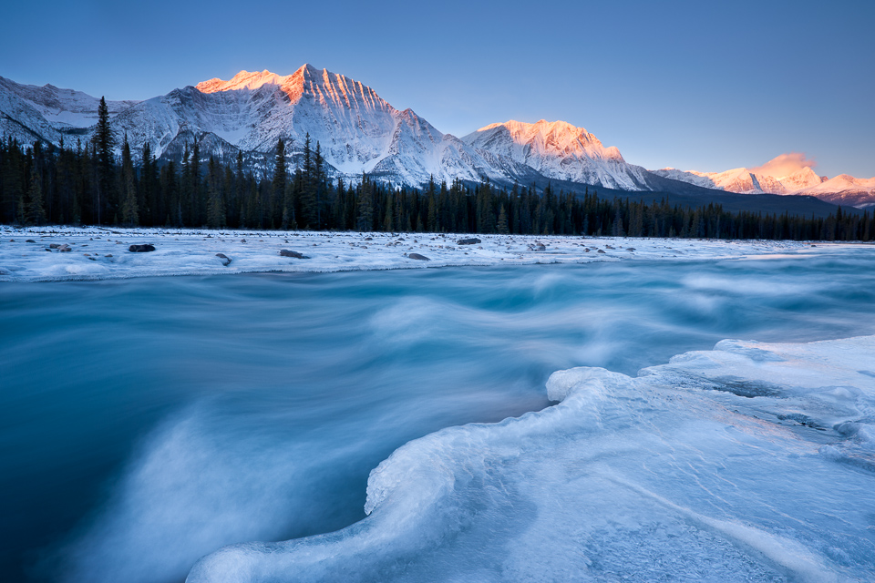 Winter sunrise on the Athabasca River with Mt. Fryatt, Mt. Geraldine, Whirlpool Mountain, and Mt. Edith Cavell, Jasper National Park, Alberta, Canada