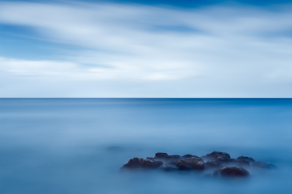 Ocean and sky long exposure image near Brennecke's Beach, Poipu, Kauai, Hawaii