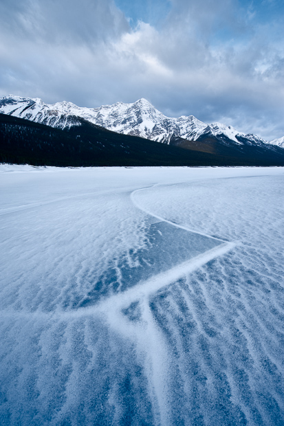 Cracked ice on Spray Lakes and the Goat Mountain Range